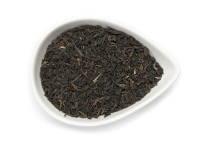 ORGANIC BLACK TEA:  Assam Tea is presented in a white bowl, certified organic and fair trade black teas available in Canada from this bulk organic tea importer.