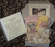 Natural Baby Gift Box Collection is pictured with both the box open and closed.  A truly lovely gift set for baby full of natural baby soap, a baby washcloth and a terry bath mitt at an inexpensive price for a quality hand made gift.  You will be proud to gift this handmade soap gift made in Canada item created by hand with no dyes, no preservatives no phthalates from chemical scent and no parabens.