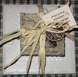 A natural bar of kitchen soap designed to take cooking odours from your hands is presented on a beige ceramic tile soap dish and tied off with a raffia ribbon.  This hand made all natural soap is decorated with a dried lime slice and makes a wonderful favor gift or attendant gift for your bridesmaids as well.