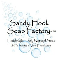 Sandy Hook Soap Factory dot com logo with a white background a bright blue bubbles in varying sizes in a sweeping pattern.  Text reads Handmade Truly Natural Soap and personal care products.